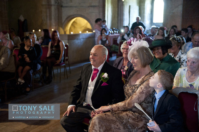 Proud parents watch their daughter getting married at Hedingham Castle
