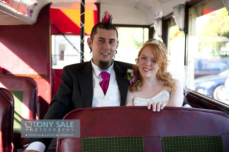 Stunning photograph of flame haired bride and her mohican husband
