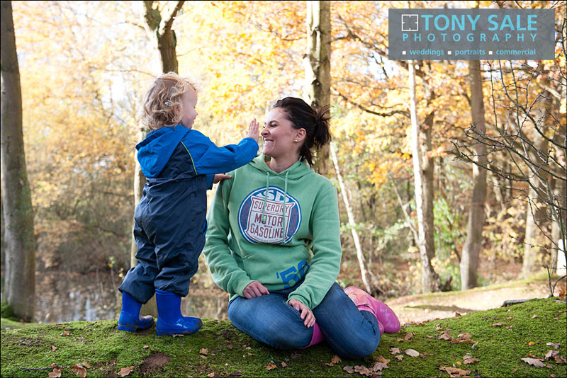 Young boy playing with his mum in pink wellies