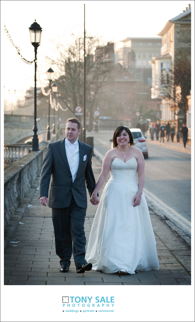 Bride and groom stroll along by the river Great Ouse in Bedford