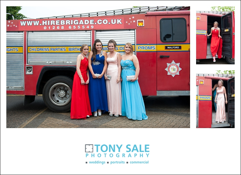 Girls posing in front of a fire engine