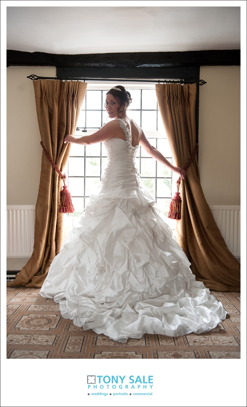 Bride poses in her stunning wedding dress
