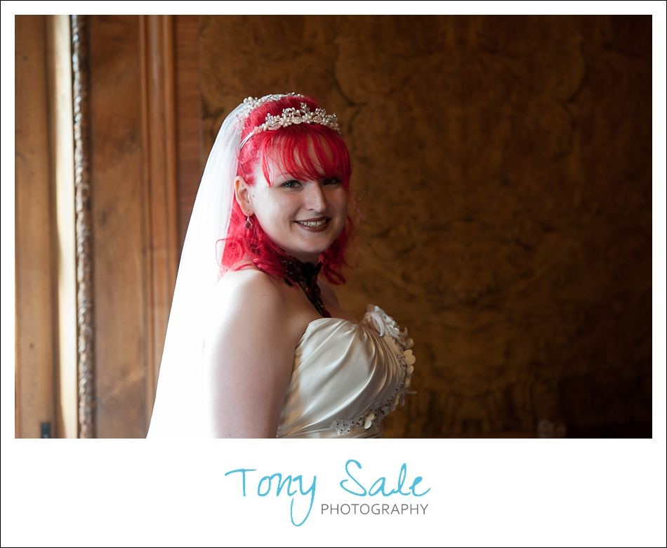A beautiful smile from the bride just before she enters the ceremony room