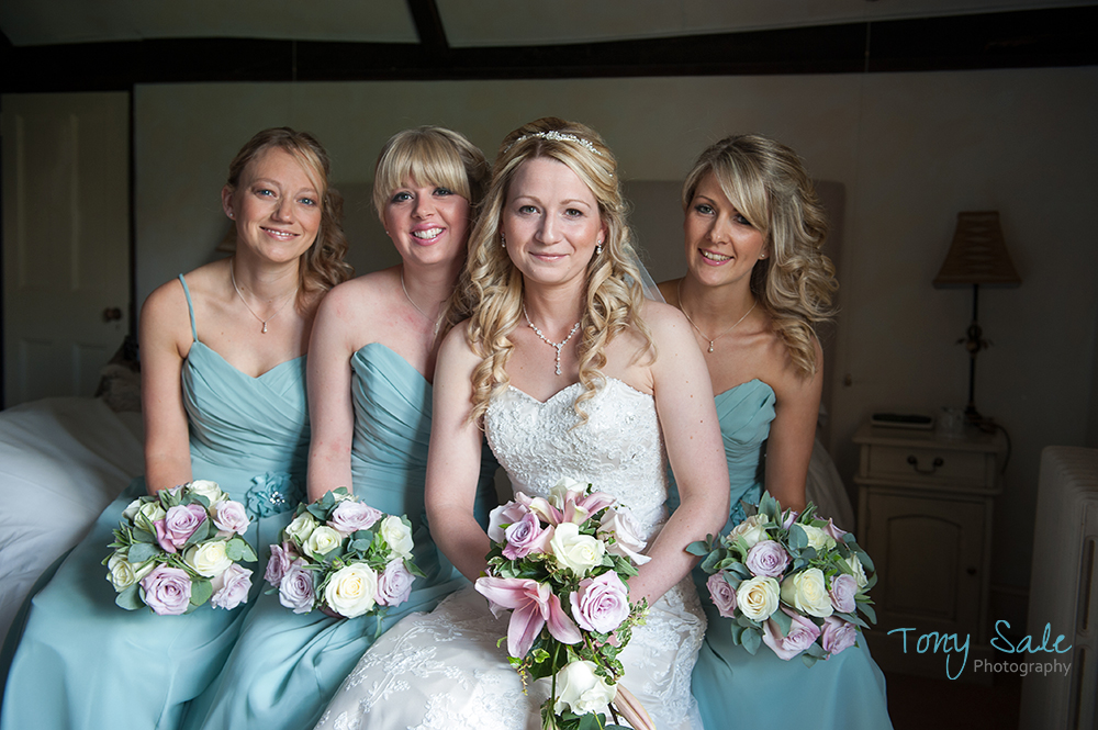The Bride and Bridesmaids pose for a fun shot together