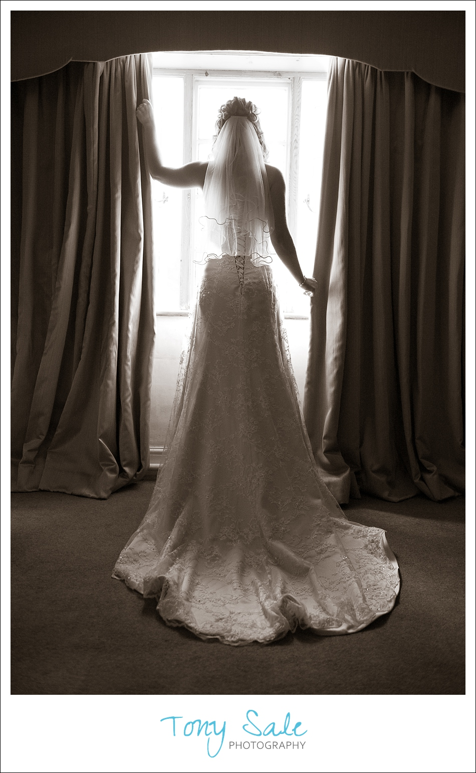 Bride posing by the window