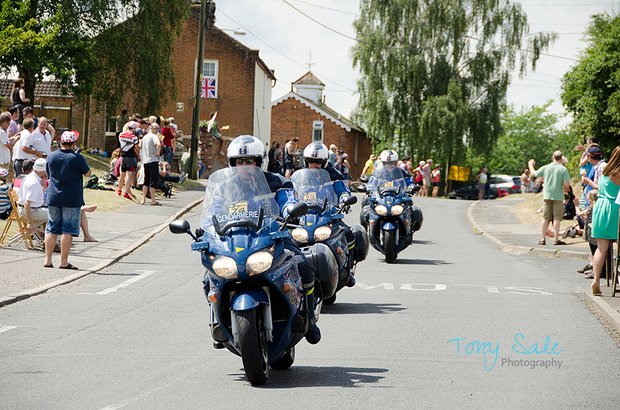The gendarmerie lead the way, the bikes follow soon