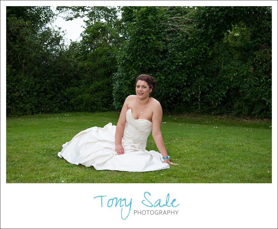Beautiful bride posing on the lawn