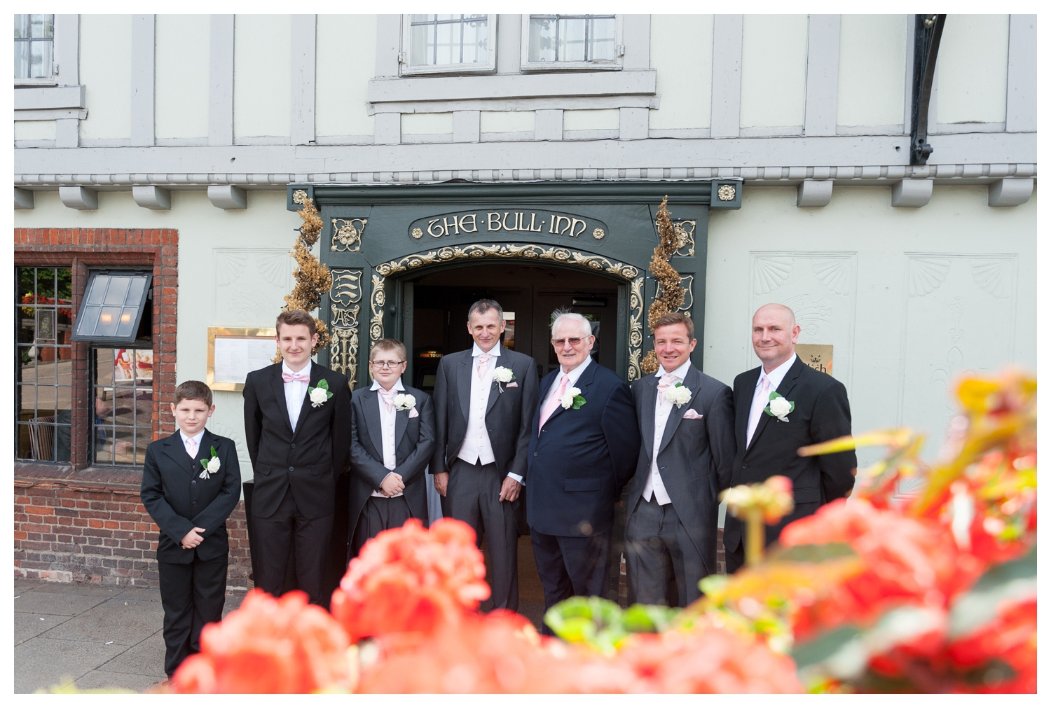 The groom and the lads outside The Bull Hotel
